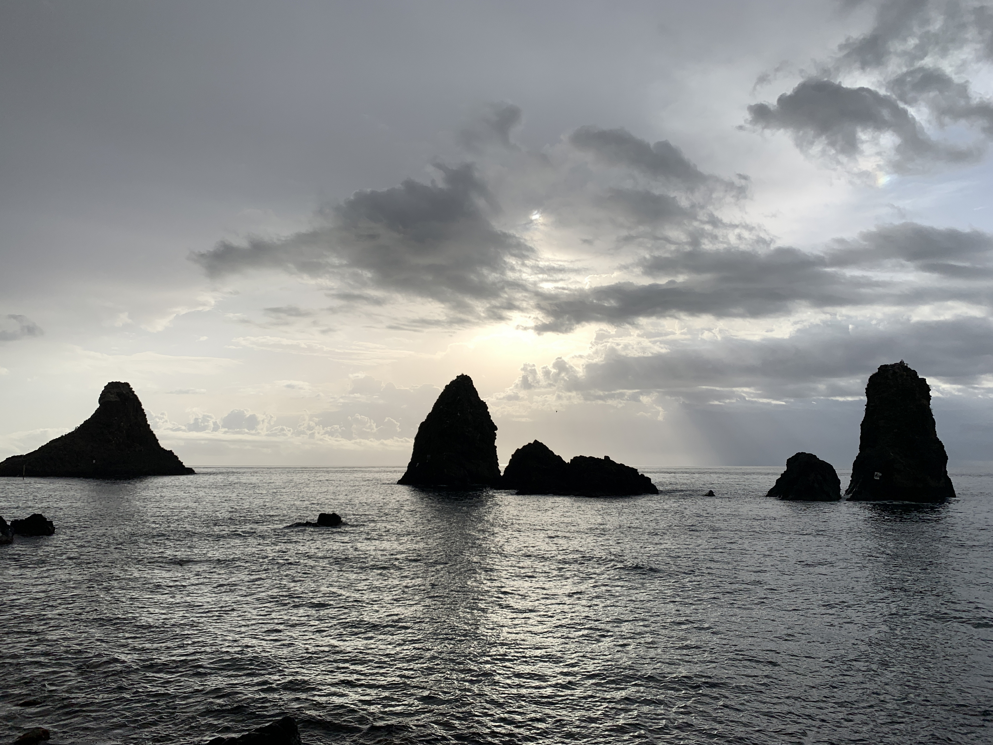 The Islands of the Cyclops, sea stacks off the coast of AciTrezza, Sicily